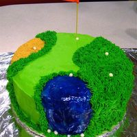 Golf Birthday Cake Birthday cake for my boss who loves golf. Chocolate cake with BC frosting/ decorations. Water is piping gel, golf balls are fondant, flag...