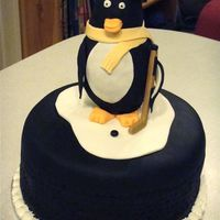 Pittsburgh Penguins Hockey This is a birthday cake for a co-worker who is a Pittsburgh Penguins Fan. The hockey puck is covered in fondant and textured on the side...