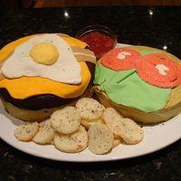Kuma Burger I made this cake for a co-worker. It is modeled after the Kuma Burger at Kuma's Corner in Chicago (his favorite!). All toppings are...