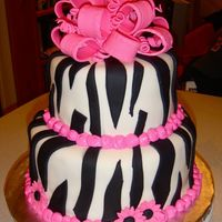 "Zebra Cake - First Tiered Cake! Thanks to CareyI for the inspiration! This is a birthday cake for two women at work. This is my first tiered cake. Bottom tier (9"") is..."