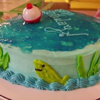 "Fish In A Pond This is my first ""fish"" cake. Buttercreme icing with piping gel ""water"" on top. The bobber is real."