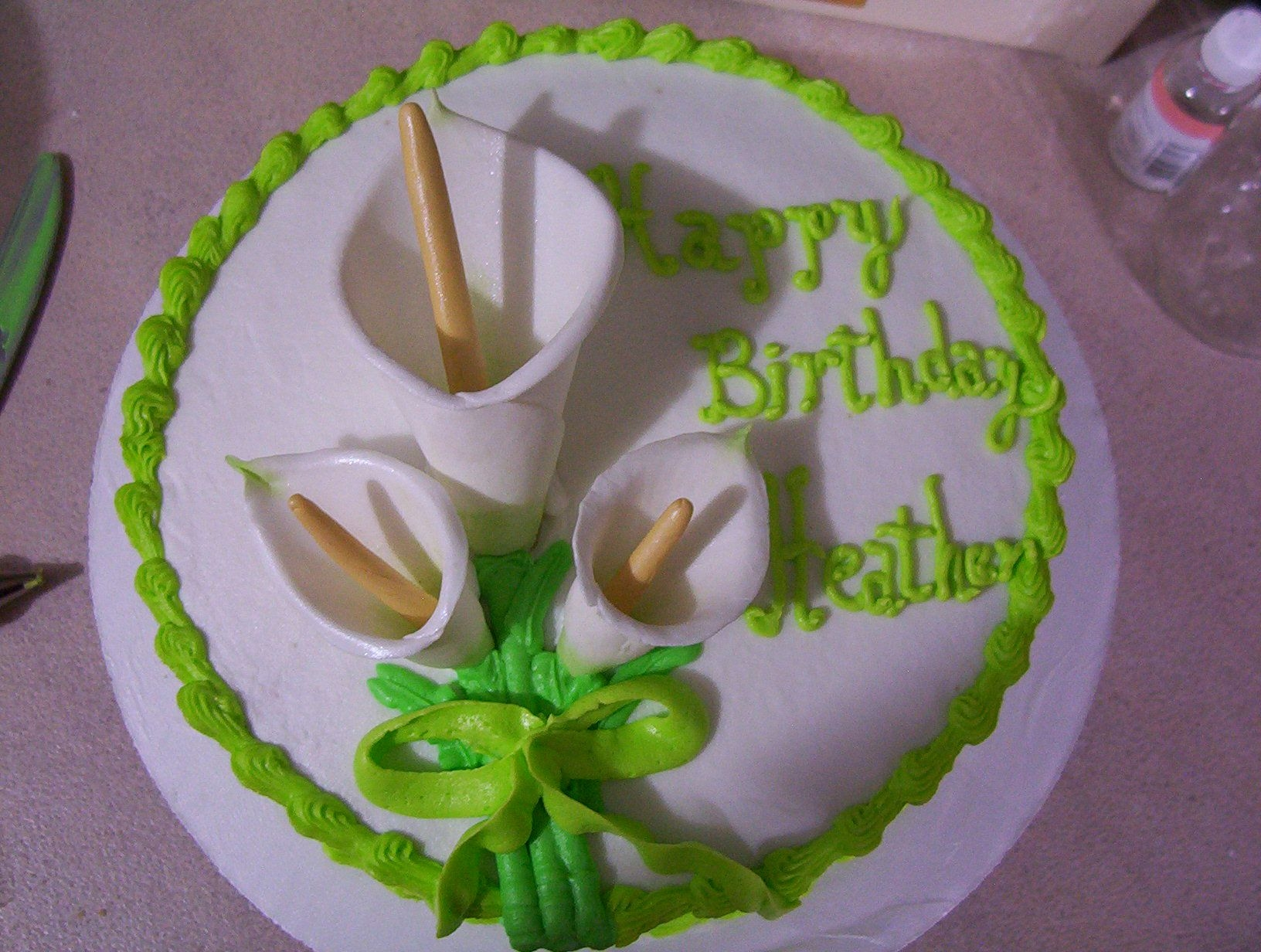 Calla Lily Birthdya Cake This is a 2 layer with buttercream frosting & gumpaste flowers. I did the words free-hand, I wish someone could tell me an easier/...