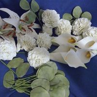 White Tiger Lilies, Calla Lilies, Carnations The carnations are made with several layers of the same size cutter using the frilling tool and dragging the ends out. They are very heavy...