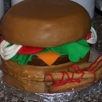 "Cheeseburger And Fries   I made this ""Darn Good"" chocolate cake with vanilla buttercream and MMF for a co-worker. Fries are sugar cookies. TFL!"