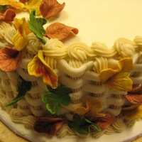 Fall Leaves red velvet cake with cream cheese filling and cream cheese icing basket weave gum paste leaves. TFL