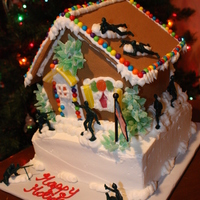 Surrender Yourself Ginger Bread Man Army men raiding gingerbread house on top of a cake