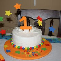 1St Birthday Carnival Theme Buttercream,fondant work. ***Wires inserted in straws before inserting into cake.