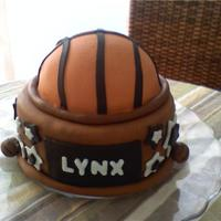 Basketball Team Trophy Cake I made this cake for my daughter's basketball team to celebrate the end of the season. Thanks for looking. It's chocolate cake...