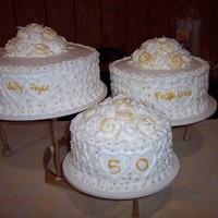 50Th Anniversary Gold Cake the piping on the side is done just free hand and the lil gold balls were each placed with tweezers! the roses are gold tipped by using the...