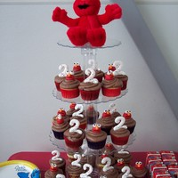 Elmos Everywhere! I did these for my grand baby's 2nd birthday. She is an elmo freak! The Elmo heads are fondant, and the number 2's are piped out...