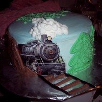 Train Track Cake I did this all in butter cream. the train is a photo cut and laminated. This was shamelessly copied from a design on here. Not my original...