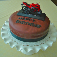 Motorcycle Cake   My friend wanted the cake very dark red with toy motorcycle...