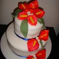 "Calla Lily Wedding Cake  This is my first wedding cake and first time making calla lilies , it was a real challenge for me!!!The cake is 2 tier 10"" and 6&quot..."