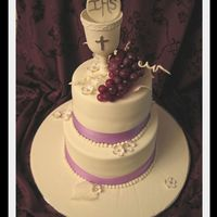 First Holy Communion Cake This was for a little girl whose favorite color was purple. Everything is edible accept for the grapes. Cup is made out of gumpaste. Thank...
