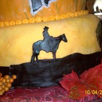Cowboy Silhouette   Fondant cowboy painted with food coloring. This was one of the silhouettes on the barn dance cake