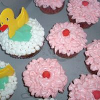 A Few Ducky Cupcakes And Pink Fora baby girl baby shower...the mom-to-be loves those little ruffle butt pants for baby girls. The ducky cupcakes are the key lime ones....