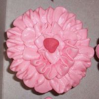 Strawberry Flower Cupcakes  Strawberry cupcake with strawberry buttercream. Strawberry candy center. Used a flower tip to make a begonia type flower. They were a hit...