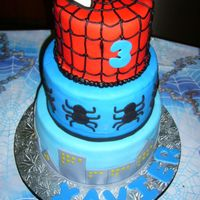 Spiderman! Chocolate and vanilla cake layered with chocolate and vanilla buttercream with chocolate chips. All MFF fondant decorations except the web...