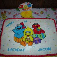 Sesame Street This was for my youngest son's 1st birthday party. Marble cake with butter cream icing, done freehand.