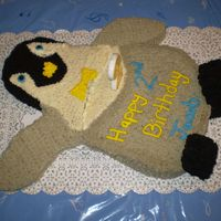 Happy Feet's Mumble Mumble penguin cake done for my son's 2nd birthday. The cake's frosting slit at one of the seems....but other than that I was...
