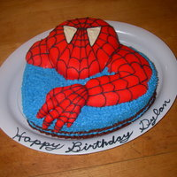 Spiderman Cake Chocolate and vanilla layered cake filled with Nutella buttercream. Cake is covered in fondant and buttercream icing.