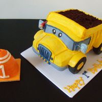 Construction Pals Dump Truck   Iced in buttercream with fondant accents. RKT covered in fondant for tires.