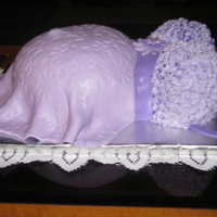 Lilac Belly Cake This was a joint effort with my daughter. We used MMF and an impression mat. The bodice was piped on with light and dark lilac buttercream...