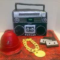 Ode To Hip Hop This cake is a tribute to the Hip Hop Era of the 80's. The BoomBox and hat are lemon cake with buttercream frosting covered in fondant...