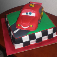Disney Cars White cake with cookies-n-cream filling. covered and decorated in fondant.