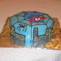 Spiderman chocolate cake with butterscotch filling. 4th birthday. Fondant covered, spiderpan made of gumpaste and web outlined in buttercream icing...