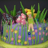 Tinker Bell  The cake is covered in MMF. All other decorations are modeling chocolate except for the butterfly. It's made from chocolate. It was my...