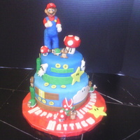 Mario Cake Cake is vanilla. Decorations are modeling chocolate & MMF.