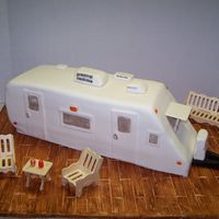 Travel Trailer Cake Made this to take to the lake this weekend. My in-laws just bought a place on Lake Gaston, complete with a trailer. This is two 1/2 sheet...