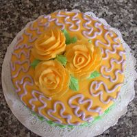 Mom's Birthday Cake I got a little loose with my cornelli lace ... it's much to large! But I like the way the roses turned out. All buttercream.