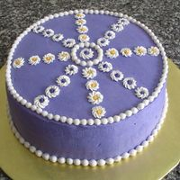 Pearl Mold Border First time I tried out my pearl mold border. Buttercream icing with royal icing flower decorations.