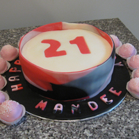 Fondant Wrapped With Cake Balls  For my niece's 21st birthday. The cake is wrapped in a multi-colored fondant strip and covered with cheesecake balls covered in...