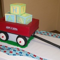 Radio Flyer Wagon With Baby Blocks This is a Radio Flyer wagon filled with baby blocks. The wheels are Rice Krispies treats covered in Fondant.