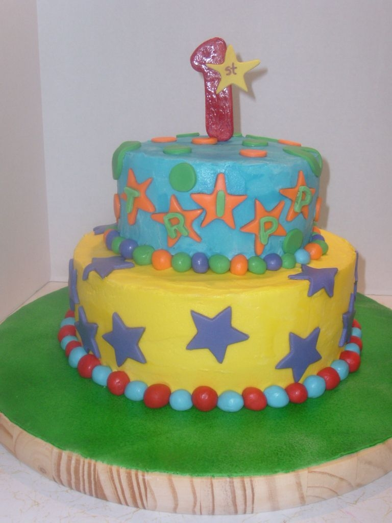 1St B.day Cake W/smash Cake   This one didnt really have a theme. It was just to match the plates. TFL