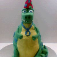 Birthday Dino   Carved fudge cake w/ foam head covered in fondant. TYFL!