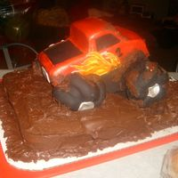 Motorized Monster Truck Cake  Vanilla bean cake w/ chocolate bc covered in bc.Carved from a 9x13 cake. Motor installed to turn from tires covered in fondant. Working...