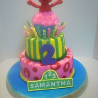 Sesame Street Cake   I got the idea off of here. Gumpaste and fondant elmo and abby. Buttercream w/ fondant accents