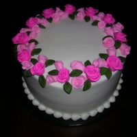 Laura_Rose.jpg Buttercream with fondant flowers.