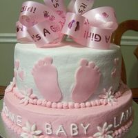 It's A Girl! This is a Strawberry cake with strawberry filling and Buttercream frosting. Gumpaste accents. Inspired by many a cute foot cakes on CC..TFL...