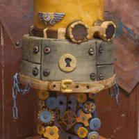 "Steampunk Cake - For The Time Machine's Captain This is a 3 tier, 6"", 8"", and 10"" round cake covered in homemade MMF and decorated with gears, chains, aviation pin, googles..."