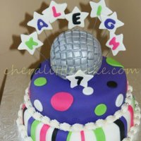 Disco This is my daughter's birthday cake. She was having a video dance party sleep over and I wanted something fun to match the theme
