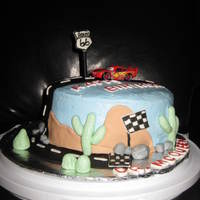 Dr. Mcqueen Cake  My friend and I made this cake for a doctor she works for. His name is Dr. McQueen and he likes to race cars! Its MMF except for the car of...