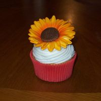 Sunflower Cupcake   Vanilla cupcakes with buttercream frosting and gumpaste sunflowers painted with airbrush