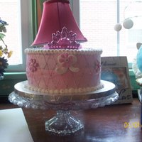 Princess Cake Vanilla cake with pink buttercream. Royal Icing bow, plastic crown (later changed to real rhinestone tiara)