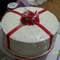 Red Velvet Cake royal icing roses w/ fondant ribbons on cake...real ribbon on roses. red velvet cake with cream cheese icing