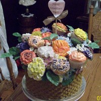 Cupcake Flower Basket basket weave on yellow cake with angel food cake cupcakes. I let my daughters pick the colors for the flowers and help decorate them for...
